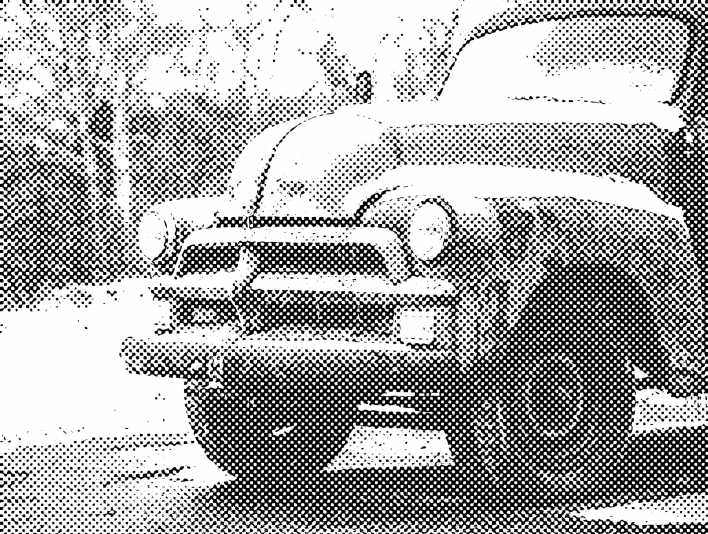 Stipplr Farm Truck Covered in Snow on Dirt Road in Forest