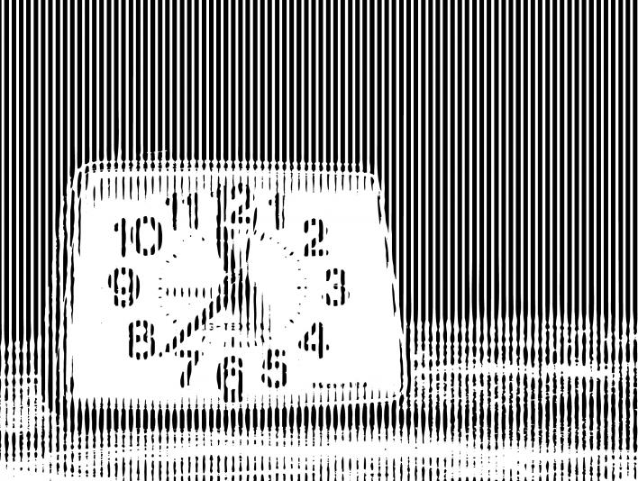 Stipplr Analog Alarm Clock On Table