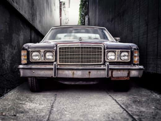 stipplr stock photo 1975 Black Ford LTD with Red Pinstriped Hood And Minor Bumper Rust