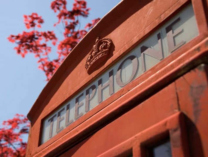 Stipplr Stock Photo England Style Telephone Booth Clear Blue Sky In Autumn
