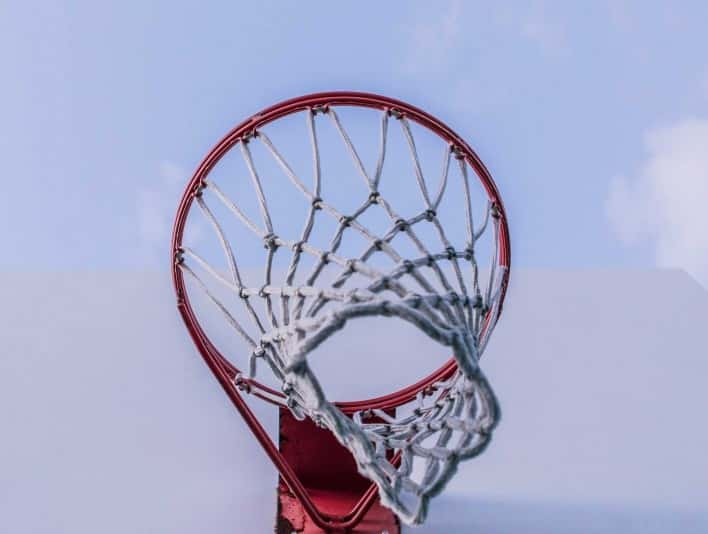 Stipplr Stock Photo Basketball Net and Backboard Against Clear Blue Sky
