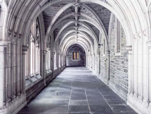 Stipplr Stock Photo Cathedral Hallway of Stone Floors Archways and Stained Glass