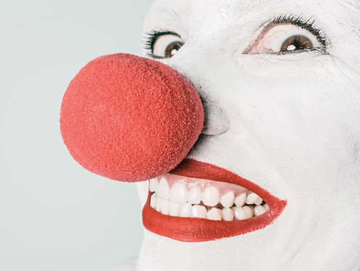 Stipplr Stock Photo Clown Makeup white facepaint bright red lips wild eyes foam nose grin teeth