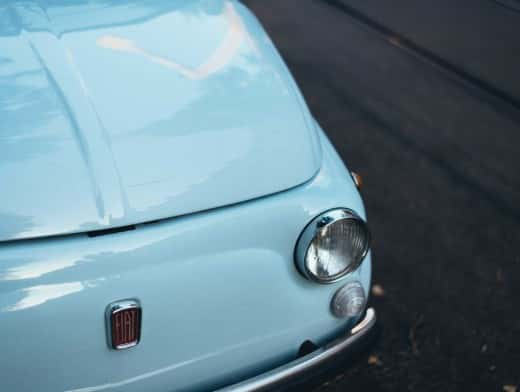 Stipplr Stock Photo Turquoise Fiat Car Parked On Paved Road
