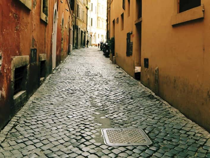 Stipplr Stock Photo Italian Cobble Stone Alley With SPQR Fonderia Romana Manhole Cover