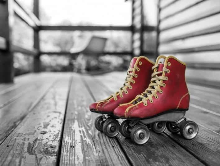 Stipplr Stock Photo Red and Yellow Steel Roller Blades