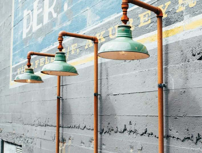 Stipplr Stock Photo Series of Lamps Mounted To The Side Of Concrete Wall